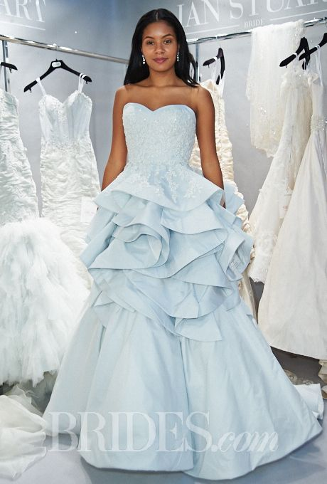 Brides.com: 34 Colorful Wedding Dresses That Prove You Don't Have to Wear White. Wedding dress by Ian Stuart  See wedding dresses from Ian Stuart's most recent bridal runway show.