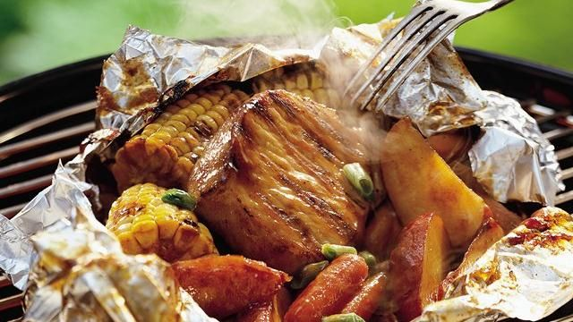 Enjoy grilled dinner tonight with this sweet and sour  packet of pork and saucy veggies – ready in just an hour!