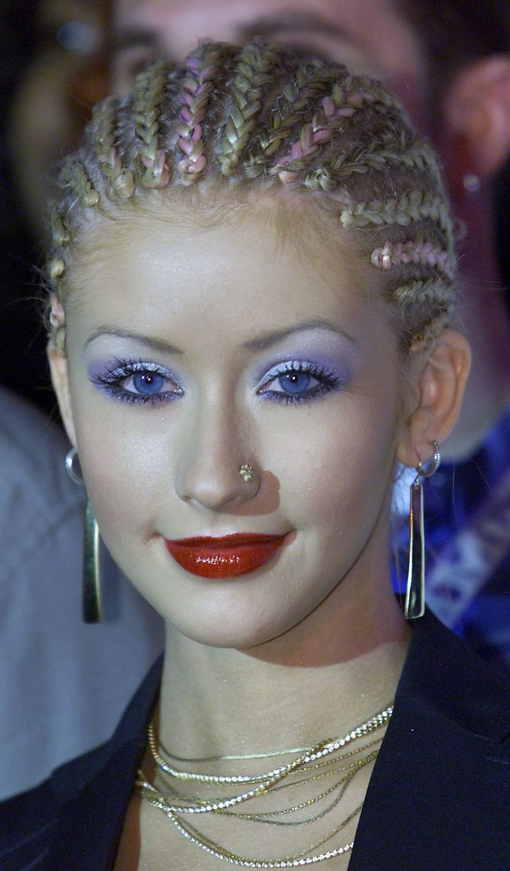 The cornrows, the purple eyeshadow, and the nose ring!