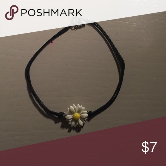 Daisy Choker Choker with daisy focal point that can be fitted to multiple sized necks. Brand new and never worn, but tags were taken off. Hot Topic Jewelry Necklaces
