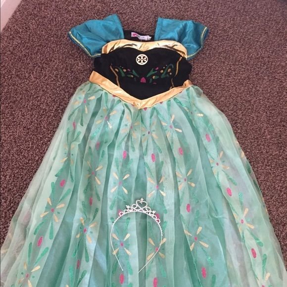 Disney frozen Ana's costume dress Brand new with tags, Disney frozen Ana costume dress.. One way of celebrating your princess birthday.  Have one left  in size 8 .  Also a beautiful tiara. Please note that this is brand new.  I tried it on my child just so clients can see how it look. Vogue Dresses