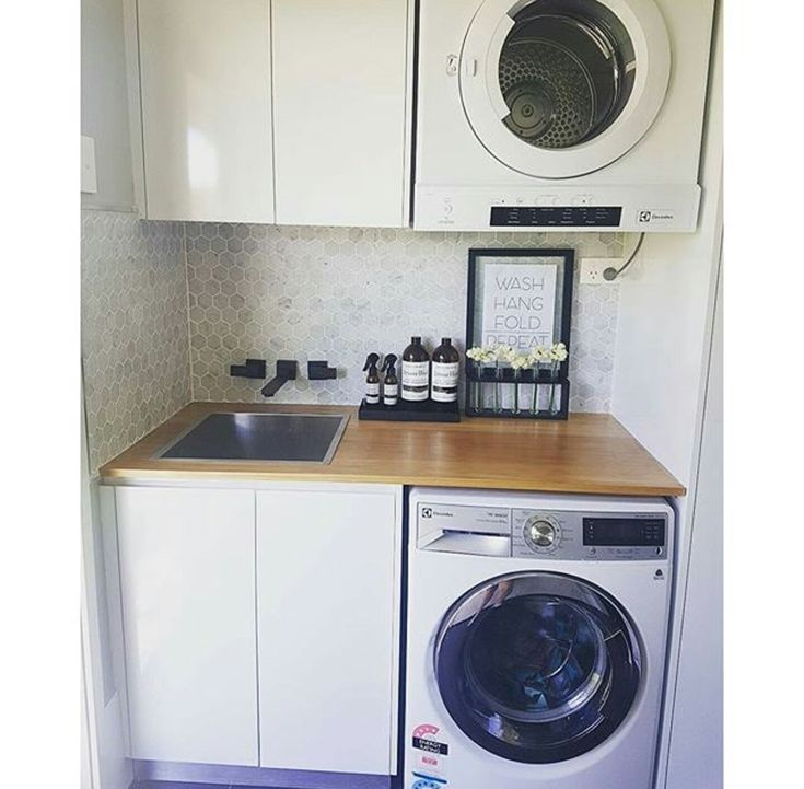 Ash | functional small laundry. I like the wood and white look.