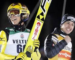 Japan's Noriaki Kasai and Switzerland's Simon Ammann celebrate their shared victory at the World Cup ski
