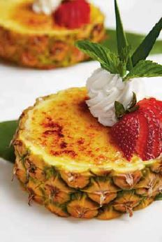 Island-inspired Pineapple Creme Brulee cut the pineapple and leave a small amount of pineapple at the bottom and fill with pastry cream then sugar and brule