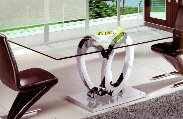 Mesa de comedor redonda de cristal con pata central de acero cromado. Diseño original Medidas disponibles: Altura 75 cm Largo 180 x 90 cm Largo 150 x 90 cm