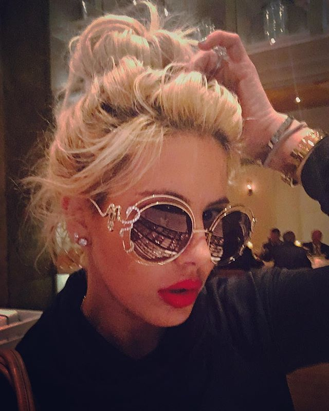 I wear my sunglasses at night, so what. Want this look? Don't brush your hair, apply red lips and find the biggest shades you own!-sdlr