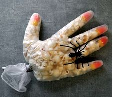 Kid Halloween treats- popcorn hand with spider ring