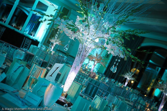 Blue Reception With Tall White Centerpieces Wedding