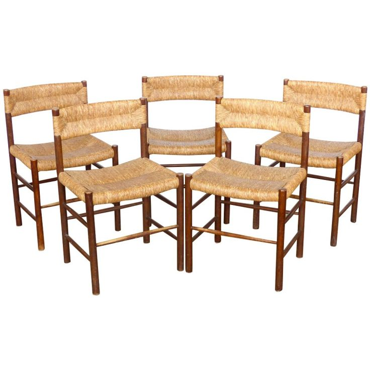 Set of 5 chairs in ashwood and straw by Charlotte PERRIAND from the 50s. Structure in brown ashwood, seat and backrest in straw. good vintage condition.