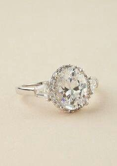 vintage ring.....one huge stone in the middle and then surrounded with smaller stones.  Throw in a few baguette side stones and you have a masterpiece!  Beautiful!