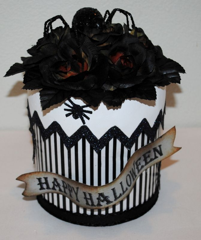 Spidery striped  centerpiece/gift box/memory box in black and white, black glittered spiders climbing up the sides to greet the large spider atop a bed of roses.  . #Halloween #Halloweendecorations #Crowcenterpieces #handmadehalloween #handmadehalloweenboxes