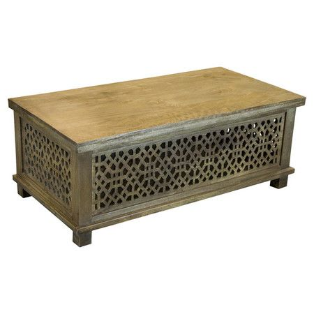 Showcasing a mango wood frame and weathered brown finish, this eye-catching coffee table is a perfect anchor for your living room or den.  ...
