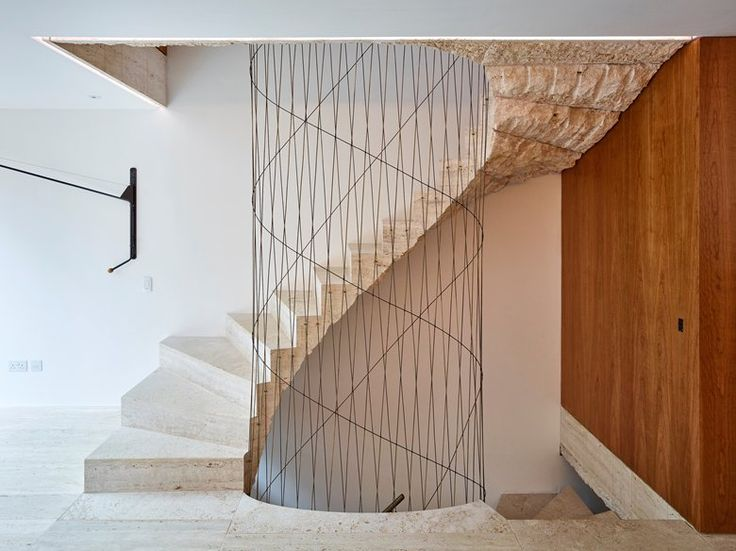 Studio Groupwork + Amin Taha renovated an apartment whose central knot is a #travertine #staircase with the shape of a #spiral
