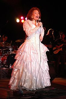 Loretta Lynn.  She rose from nothing to a wife, mother, singer, author, and country music icon with a life to be proud of.