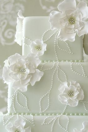 Flowers and Stitches cake. Smaller flowers would look nicer to let the stitches come out more.