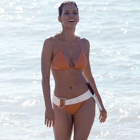 50 Years of Bond Girl Fashion: Halle Berry as Jinx in Die Another Day, 2002:  There is no one who could have paid better homage to Ursula Andress' white bikini. Halle Berry looks amazing in this orange update of the classic.