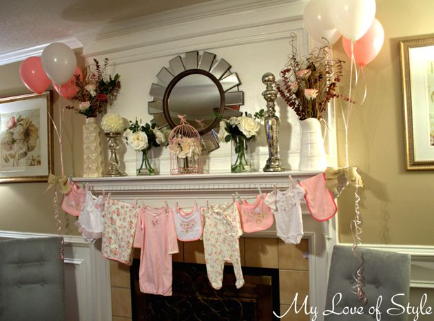 Cute baby clothes garland at a Baby Shower!  See more party ideas at CatchMyParty.com!