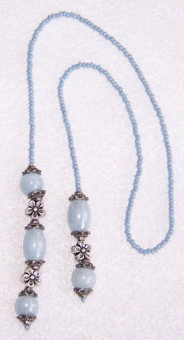 """Bluer Shade Of Pale"" handmade beaded book thong...pastel blue seed beads and glass beads with silvertone flower beads and bead caps."