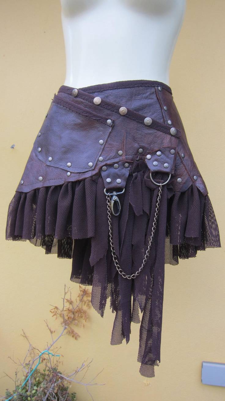 "tribal leather mini skirt belt/ with pocket,lace and stud detail....44"" to 50"" hip. $80.00, via Etsy."