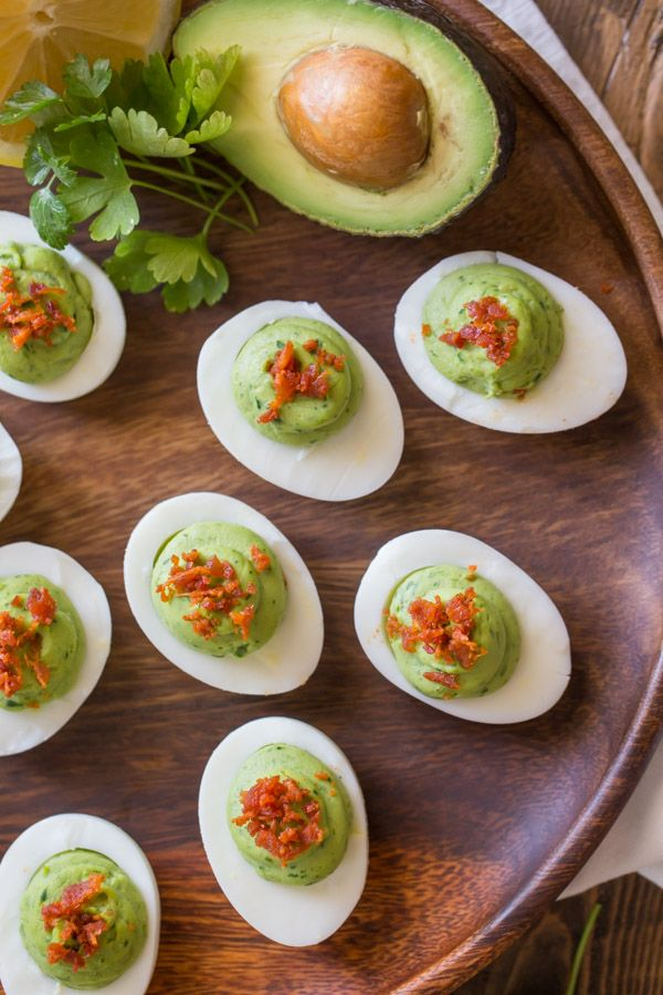 These Smoky Bacon Avocado Deviled Eggs are a great way to spice up your traditional Easter menu.