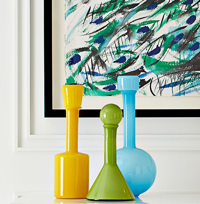 These Jonathan Adler Pop Decanters are colorful glass carafes. Try them in multiples on your living room shelf and mix and match the stoppers for a bold, mod statement.