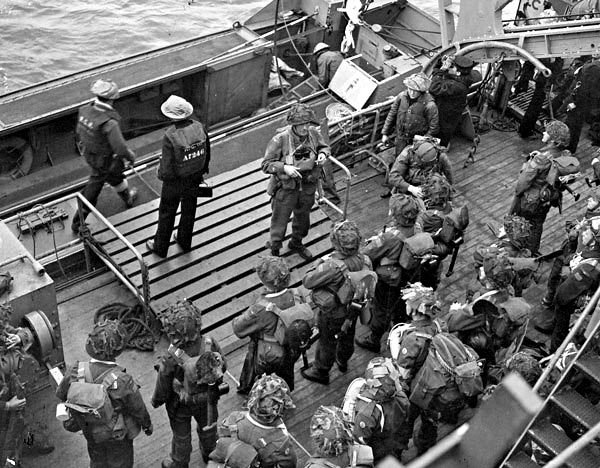 D-Day, Juno Beach: Infantrymen of the 1st Battalion, The Canadian Scottish Regiment, embarking in a Landing Craft Assault (LCA) alongside H.M.C.S. Prince Henry off the Normandy beachhead.