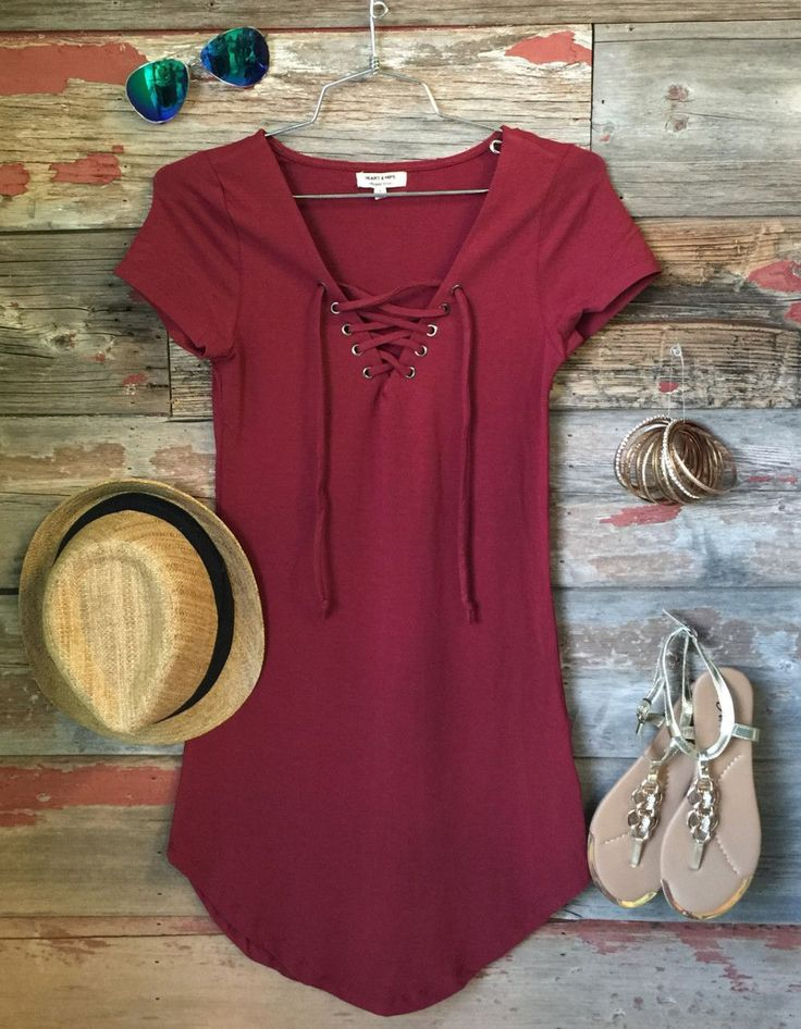 The Fun in the Sun Tie Dress in Burgundy is comfy, fitted, and oh so fabulous! A…