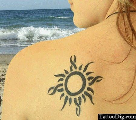Sun Tribal Shoulder Tattoo