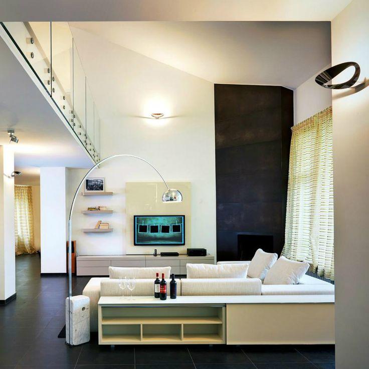 Artemide Mesmeri e Flos Arco rendono la tua casa accogliente, moderna e rilassante!