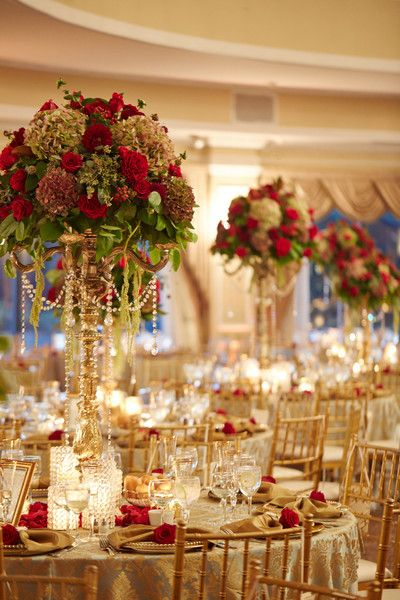 Gold reception decor idea - round banquet tables, gold table linens + tall centerpieces {My Bellissima}