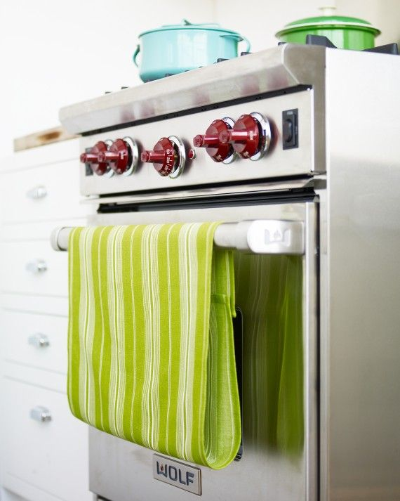 Hanging a dish towel from an oven door makes sense -- the towel is always at the ready, and the oven's warmth quickly dispels dampness. Here's a way to improve on the idea, keeping the towel from slipping off.