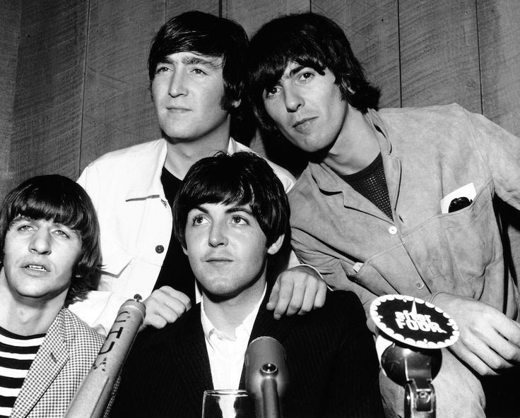 The Beatles posing at a press conference on Aug. 17, 1965.
