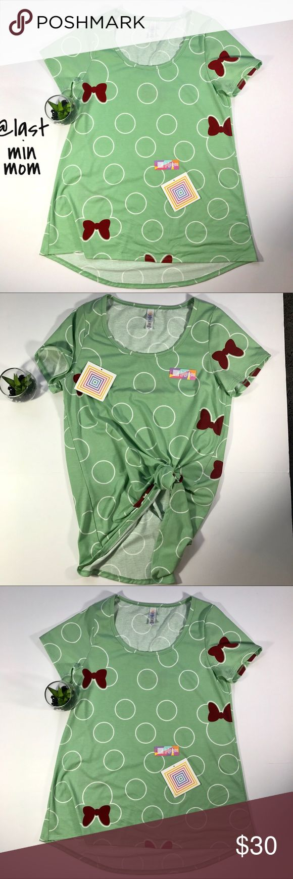 ‼️LULAROE ‼️DISNEY‼️ CLASSIC TEE‼️ Lularoe Disney Classic Tee  Size XS  Brand New w detached tags. Mint green w Burgundy Bows and White polka dots!!! Adorable!!!!! Perfect for any Disney and Lularoe Fan!  27' length in back  25' length in front Bust 32' Perfect w leggings or jeans. Super comfy and soft.  Cute short sleeves. LULAROE Tops Tees - Short Sleeve