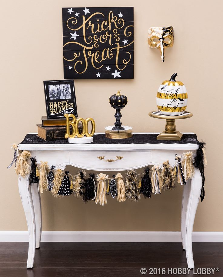 Add glam to your mantel or entryway for a fresh spin on this spooktacular holiday! DIY the tassel garland by bunching yarn and ribbon of your choice.