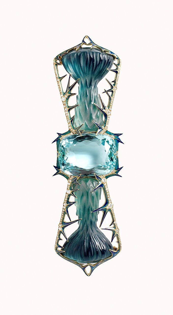"RENÉ LALIQUE | AN ART NOUVEAU AQUAMARINE, GLASS, ENAMEL AND DIAMOND ""THISTLES"" CORSAGE ORNAMENT. Centering upon a cushion-cut aquamarine, flanked on either side by a symmetrical articulated pair of thistles, made of sculpted bluish green tinted glass, within an openwork rose and old European-cut bow-shaped frame, decorated with green and blue enamel spiked stems, the reverse with gold engraving, mounted in 18k gold, circa 1905."