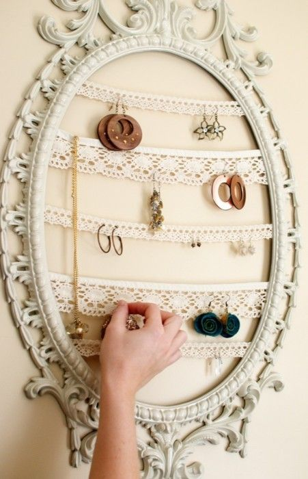 DIY jewlery hangers. I'm not a fan of rustic but I like the idea of taking any frame and taking out the back and using ribbons to hang everything. I will definitely be doing this! I'm so jewelry disorganized!