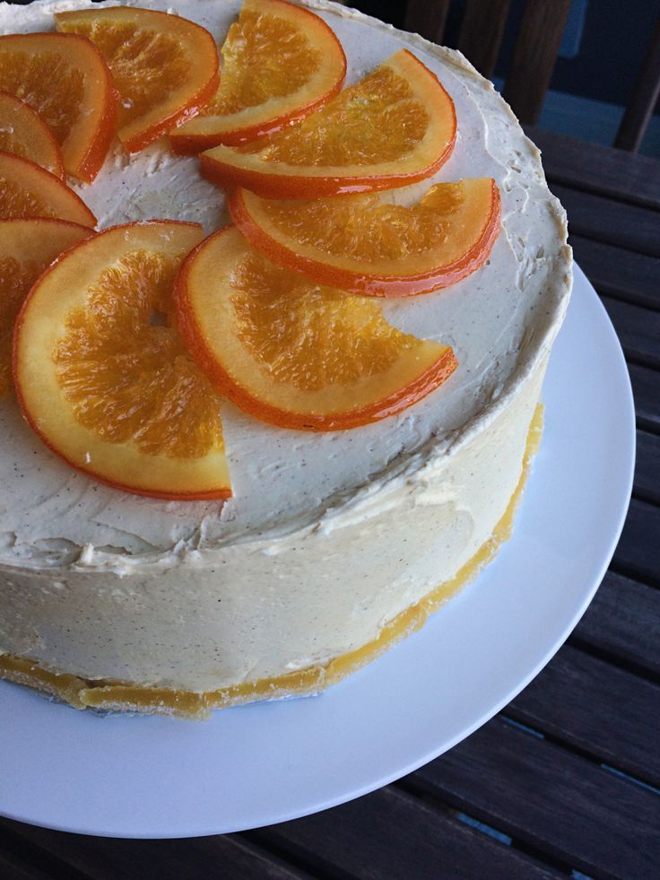 Orange Ginger Layer Cake with Cinnamon Molasses Buttercream and Marmalade filling, topped with Candied Orange Slices and lined with Candied Ginger! Citrus lovers try this cake!