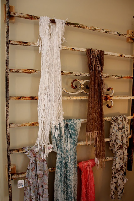 Trellis or old fence hanging on wall to display scarves. YOU MIGHT WANT TO PAINT WITH CLEAR VARNISH, OR SOME TYPE OF CLEAR PAINT,, TO PREVENT SNAGS FROM YOUR SCARFS.