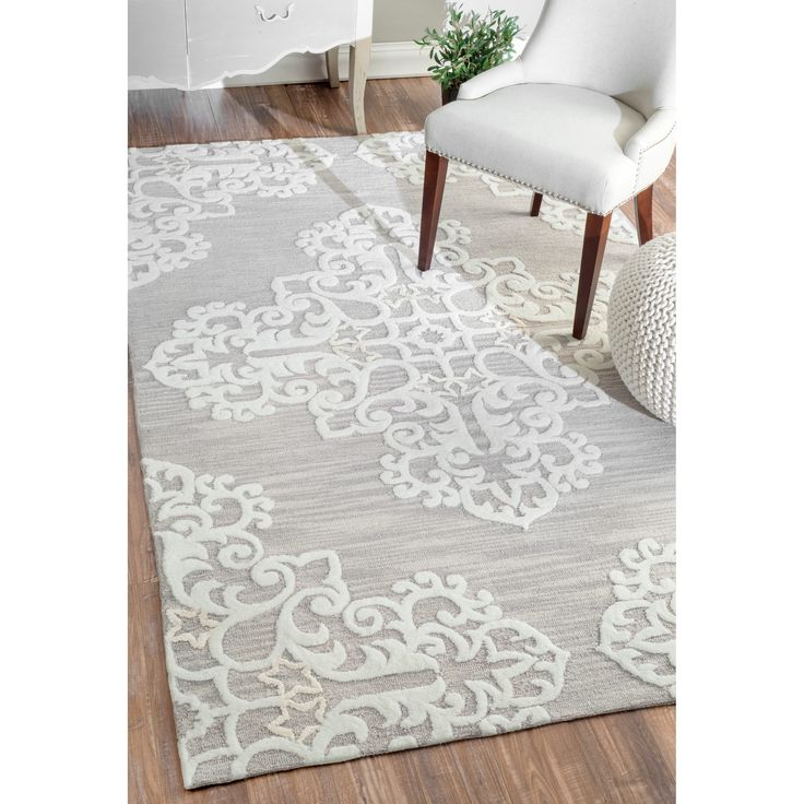 Quality meets value in this beautiful modern area rug. Handmade with Polyester to prevent shedding, this plush area rug will enhance any home decor. Pile Height: 0.25 - 0.5 inch Material: Polyester, V