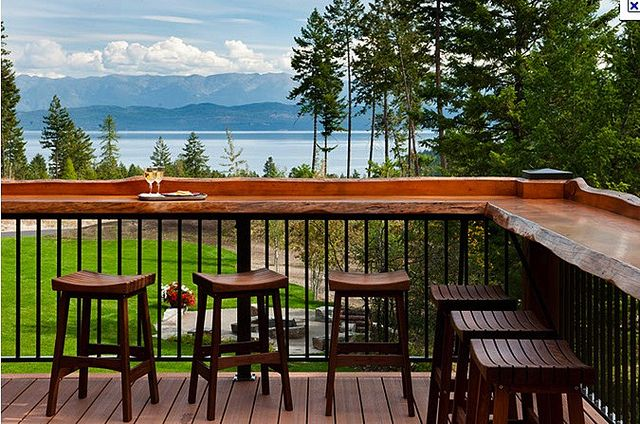 built in bar - not slab of tree through; add horizontal slats 1x4 or smaller as railing design