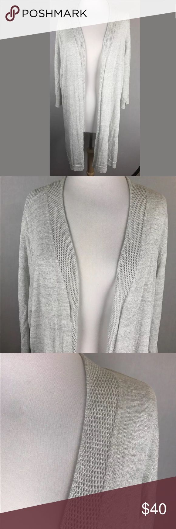 "Nic + Zoe silver cardigan sweater Nic + Zoe Size 2x Silver gray with a hint of shimmer Nice light weight.  Cardigan  Excellent pre-owned condition  Measurements (laying flat, unstretched) Shoulder to shoulder across the back 20.5"" Under arms across the back 30"" 35.5"" down center of back NIC + ZOE Sweaters Cardigans"