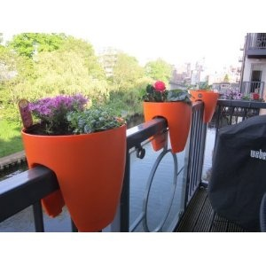 Fantastic idea for a garden fence and Balcony,  Not just designed well also save space and very visible- start growing in style .    Modern, sleek saddle planter for balconies and railings, indoors and out.Orange railimg /fence/garden plant pot: Amazon.co.uk: Garden & Outdoors