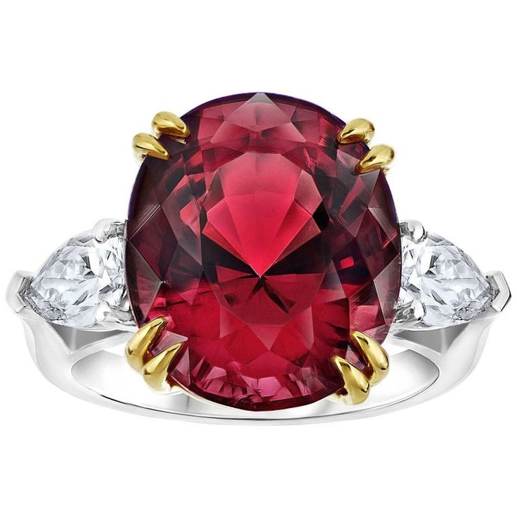 Striking 15.13 Carat Oval Red Spinel Diamond Ring | From a unique collection of vintage engagement rings at https://www.1stdibs.com/jewelry/rings/engagement-rings/