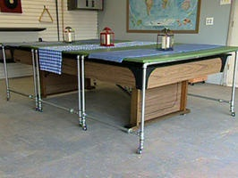 Rolling Pool Table Cover! Now that I have a pool table in my living room may need to consider this.