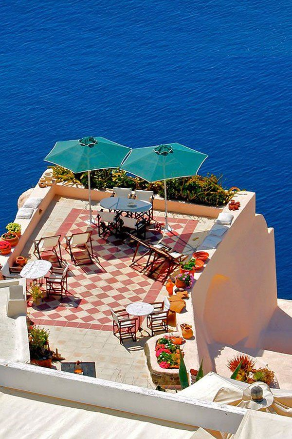 I want to be sitting under one of those umberellas!! Aegean Terrace View in Santorini , Greece