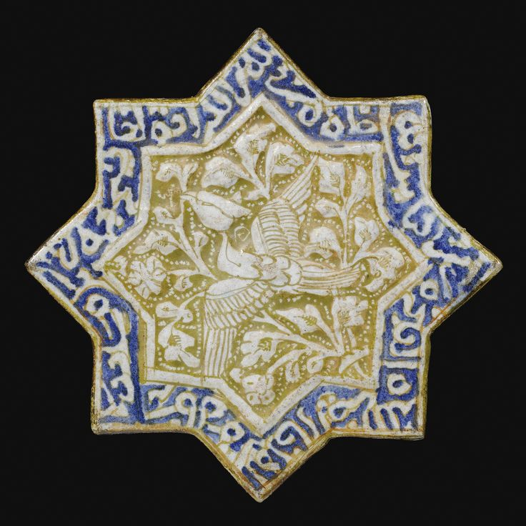 A KASHAN LUSTRE STAR TILE, PERSIA, 13TH CENTURY