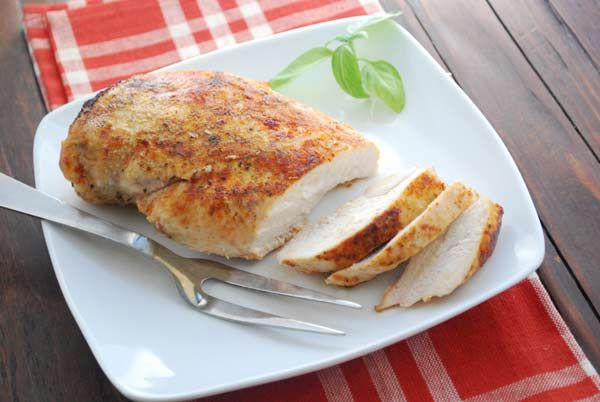 The secret to juicy chicken breasts? Bake for a short time at a high temperature. Baking for 30-40 minutes at 350 degrees F will yield dry meat. But baking for just 20 minutes at 450 degrees F will result in delightfully juicy chicken breasts, every time.