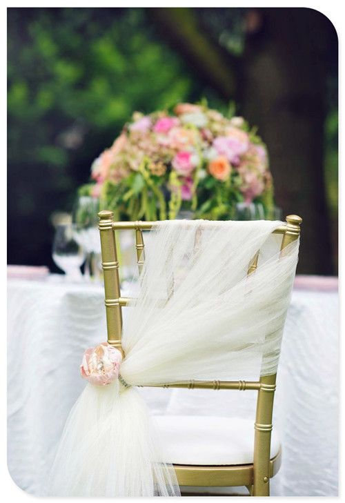wedding decoration ideas for chairs . I like how it's different other then just a big tied bow in the back