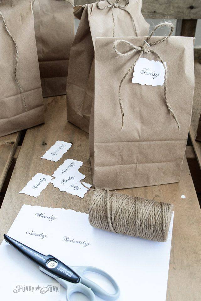 Brown paper bags with twine bows / Treat bags for one sweet cat sitter via FunkyJunkInteriors.net