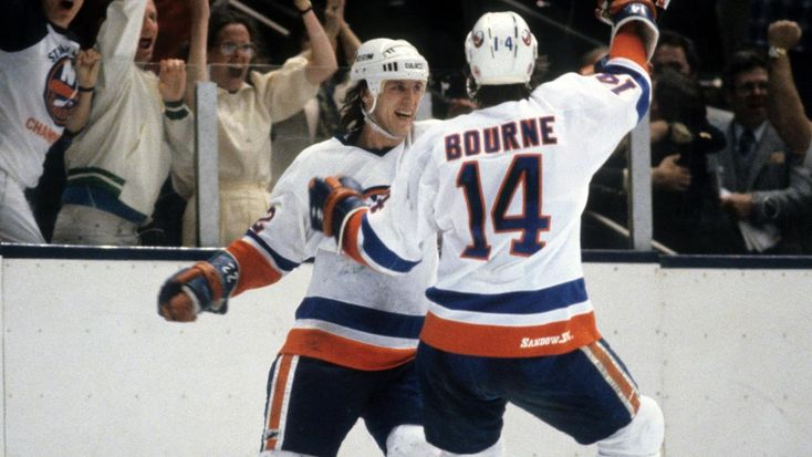 UNIONDALE, NY - MAY 8: Mike Bossy #22 of the New York Islanders celebrates his game-winning goal with teammates Butch Goring #91 and Bob Bourne #14 in the first overtime of Game One of the 1982 Stanley Cup Finals againt the Vancouver Canucks at Nassau Coliseum on May 8, 1982 in Uniondale, New York. The Islanders defeated the Canucks 6-5 in the first overtime of Game One of the 1982 Stanley Cup Finals. (Photo by Bruce Bennett Studios/Getty Images)